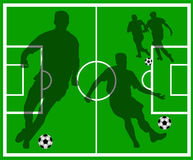 Green soccer field with player silhouettes Stock Photography