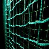 Green soccer goal net. On black background Stock Images