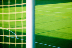 Green soccer net detail with sport grass field Stock Photos