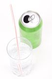 Green soda can and glass Stock Image