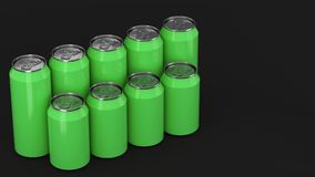 Green soda cans standing in two raws on black background. Big and small green soda cans standing in two raws on black background. Beverage mockup. Tin package of Royalty Free Stock Photography