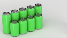 Green soda cans standing in two raws on white background. Big and small green soda cans standing in two raws on white background. Beverage mockup. Tin package of Royalty Free Stock Photo