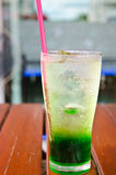 Green soda syrup mixture. Stock Photo