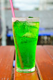 Green soda syrup mixture. Royalty Free Stock Photos
