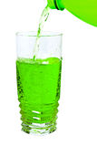Green soda in a tall glass, pour from the bottle Royalty Free Stock Photo
