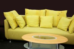 Green sofa. Interior decoration green sofa with pillows and coffee table Royalty Free Stock Photo