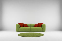 Green sofa with carpet Stock Images