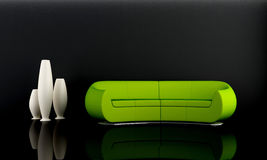Green sofa in dark room Royalty Free Stock Image