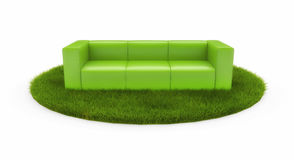 Green sofa on green field Royalty Free Stock Images