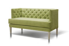 Green sofa. Isolated on white background Royalty Free Stock Photography