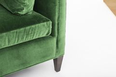Green sofa isolated on white background. A daybed couch on a white background stock photos