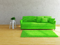 Green sofa near the wall. Green sofa with pillows near the concrete wall Royalty Free Stock Photo