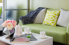 Green sofa with pillows Stock Photo