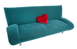 Green sofa with red heart shaped pillow Royalty Free Stock Image