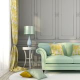 Green sofa yellow pillows Stock Photo