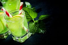 Green soft drink with lemon and lime, selective focus. Food still life stock photo