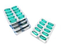Green soft gel capsules pills in blister pack. Isolated on white background Royalty Free Stock Photography