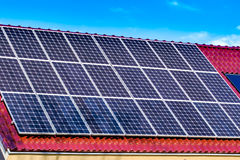 Green solar energy panels. On the roof of a domestic house facing the sun and producing electricity Stock Photo