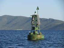 Green Solar Powered Light Buoy Stock Photography