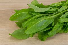 Green sorrel leaves. On the wood background Stock Image