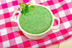 Green soup. Green chervil soup on a checkered tablecloth Stock Photo