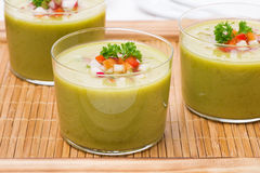 Green soup with fresh vegetables on a wooden tray, close-up Royalty Free Stock Photo