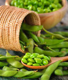 Green soy beans in the wood bowl on table Stock Photography