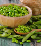 Green soy beans in the wood bowl on table Royalty Free Stock Image