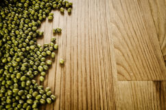 Soybeans on wooden background Stock Photography