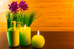 Green spa bath products concept with candles Stock Photos