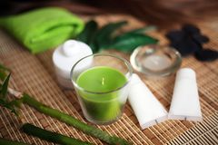 Green Spa tools with candle and towel on wood Royalty Free Stock Images
