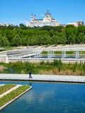 Green spaces of Madrid Rio with the Almudena Cathedral in background. Royalty Free Stock Images