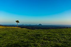 Green spacious terrain in blue sky stock photos