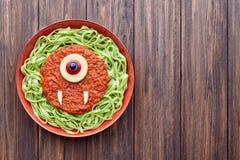 Green spaghetti creative pasta halloween food cyclopes monster meal stock photos