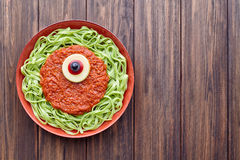 Green spaghetti creative pasta halloween party food cyclopes monster Royalty Free Stock Images