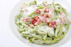 A green spaghetti pasta with bacon and cream Stock Photo