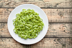 Green spaghetti pasta halloween vegetarian food holiday decoration kid party meal Royalty Free Stock Images