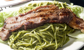 Green spaghetti tallarin saltado steak Peru Stock Image