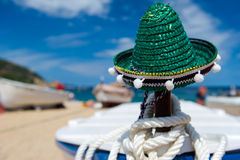 Green Spanish straw hat at beach. Green Spanish straw Sombrero in sand at the beach Royalty Free Stock Photos