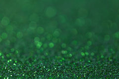 Green sparkling background from small sequins, closeup. Brilliant backdrop. Dark green sparkling background from small sequins, closeup. Brilliant and diamond Royalty Free Stock Photos