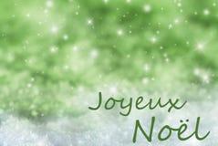 Green Sparkling Background, Snow, Joyeux Noel Means Merry Christmas Royalty Free Stock Photos