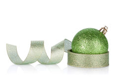 Green sparkling christmas bauble with ribbon. Isolated on white background Royalty Free Stock Images