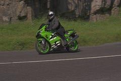 Green speed machine. Green motorbike at speed in Cheddar Gorge, Somerset, England - Background blurr Royalty Free Stock Photo
