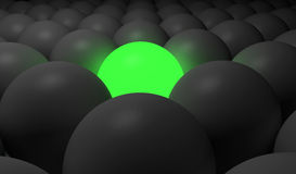 Green Sphere. 3d image of a green glowing sphere around a lot of dark spheres Stock Image