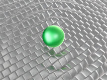 Green sphere on grey cubes Royalty Free Stock Images