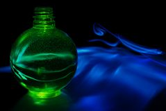 Green sphere with smoky background Stock Photos