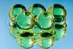 Green spheres in water. Green spheres, it is photographed in water Royalty Free Stock Photo