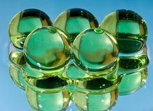 Green spheres in water. A photo close up Royalty Free Stock Photo
