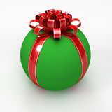 Green spherical gift box with red ribbon Royalty Free Stock Image