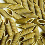 Green spinach flavored pasta penne Royalty Free Stock Photography